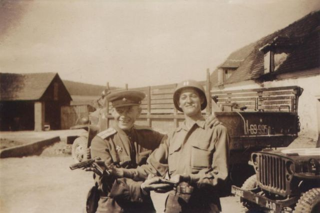 Russian Lt. and Capt. Sam H. Ball, Jr. with pistols WWII