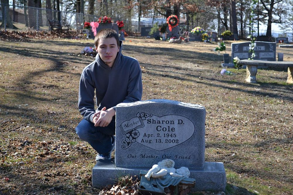 Justin Cole at Sharon Cole's grave