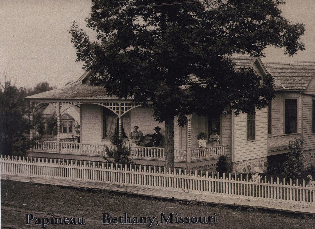 Roleke Family House in Bethany Missouri. William, Anna, Helen and Kathryn on porch.